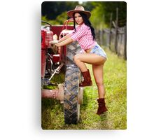 Sexy farmer girl in hat near the tractor Canvas Print