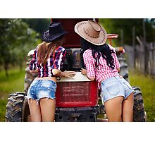 Sexy female farmers fixing the tractor Photographic Print