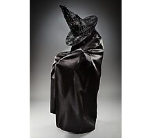 Witch wearing black attire with face hidden Photographic Print