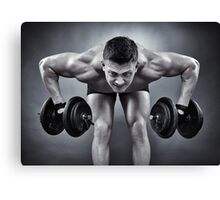 Athletic man working with heavy dumbbells Canvas Print