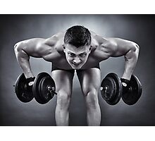 Athletic man working with heavy dumbbells Photographic Print
