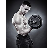 Athletic man working out with heavy dumbbells Photographic Print
