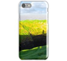 shadows of tourists looking into the nine daughters hole iPhone Case/Skin