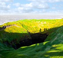 shadows of tourists looking into the nine daughters hole by morrbyte