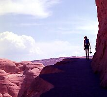 Hiker on Arches Nat'l Park Trail by SteveOhlsen