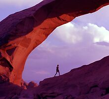 Man Walking Under Arch near Sunset by SteveOhlsen