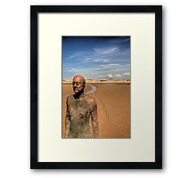 Iron Man looking out to sea Framed Print
