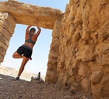 Woman worksout in ancient ruins in the desert  by PhotoStock-Isra