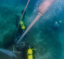 professional Scuba divers perform an underwater survey  by PhotoStock-Isra