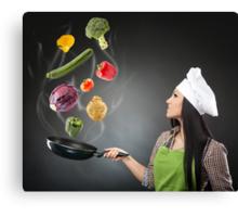 Skillful cook lady throwing veggies Canvas Print