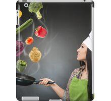 Skillful cook lady throwing veggies iPad Case/Skin
