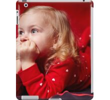 Pensive toddler girl laying in bed with hands on chin iPad Case/Skin