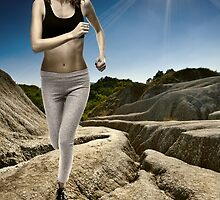 Athlete running with the sun behind by naturalis