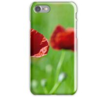 Poppies closeup with selective focus in a field iPhone Case/Skin