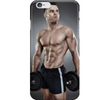 Young athletic man holding two heavy dumbbells iPhone Case/Skin