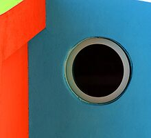 Circle window on a blue wall by fabricedeloor