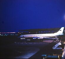 Tupolev Tu-114 at night by John Schneider