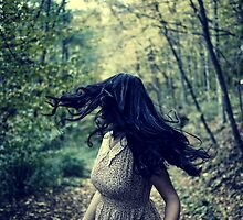 Scared girl running in the forest by naturalis