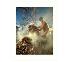 Old farmer burning dead leaves Art Print