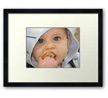 Baby Meets Cookie Framed Print