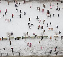 First snow, kids at school playground by Akif  Kaynak