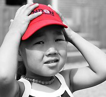 Mongolian Girl with Red Cap by Christopher Meder