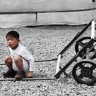 Mongolian Boy with Cart by Christopher Meder