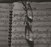 Glasses and Sheet Music, sepia tone photograph by bjphotographs