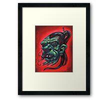 Shrunken Zombie Head Framed Print