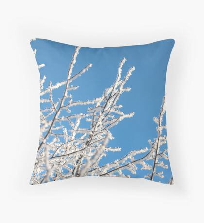 frost trees covered against the blue sky Throw Pillow