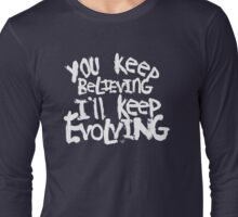 Believing vs. Evolving (wht) by Tai's Tees Long Sleeve T-Shirt