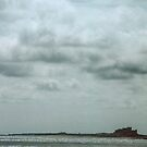 Bamburgh castle from Holy Isle Northumberland England 198405290013 by Fred Mitchell