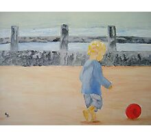 A child on the beach chasing the ball Photographic Print