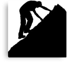 Silhouette of a man climbing a rock Canvas Print