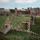Looking down on ruined monastery from limiting wall Holy Isle Lindisfarne Northumbria England 198405290020 by Fred Mitchell