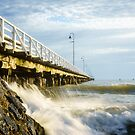 Waves Breaking by the Pier by Silken Photography