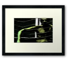 caught in the middle Framed Print