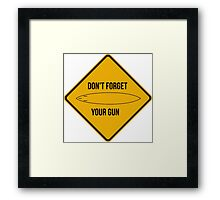 Don't forget your gun. Framed Print