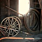 Carriage Wheels inside the Wheelswright Barn by Jane Neill-Hancock