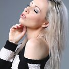 Blonde in black and white top by Peter Stone