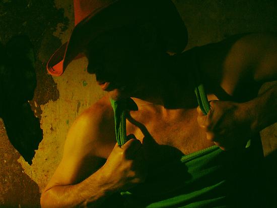 His Red Cowboy Hat by Robert Knapman