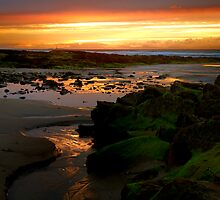 Sunset on the skerries by Jim Robertson