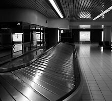 3 AM AT THE AIRPORT BAGGAGE MOVER by Reese Forbes