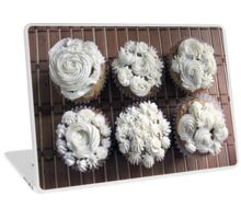 beautiful homemade cupcakes with decorative white creamy frosting flowering top.  food art.  Laptop Skin