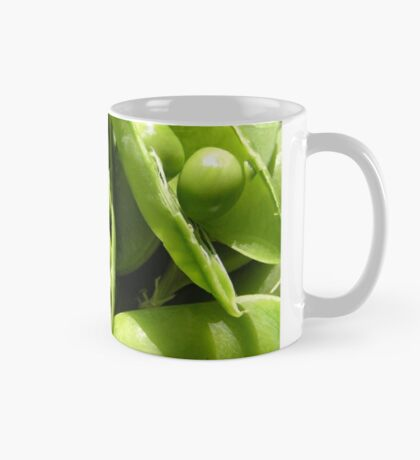 Fresh open green pea pods in sunlight Mug