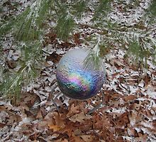 gazing ball and evergreen branches in small snow by Laurkat