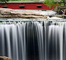 Waterfall and Red Covered Bridge by Kenneth Keifer