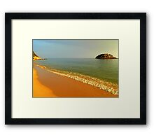 the sea kisses the earth incessantly... Framed Print