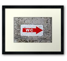 """sign """"WC"""" on the rough concrete wall Framed Print"""