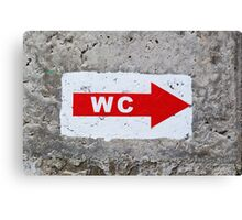 "sign ""WC"" on the rough concrete wall Canvas Print"